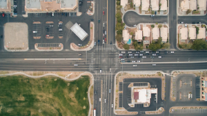 bird-s-eye-view-cars-crossing-crossroad-large